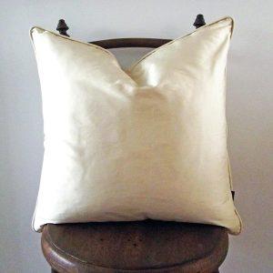 cream silk piped cushion