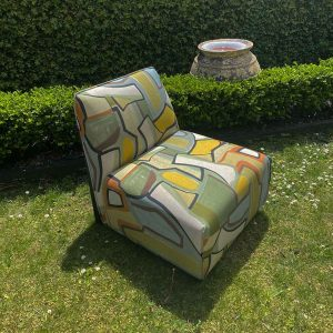 upcycled armless chair with graffiti fabric