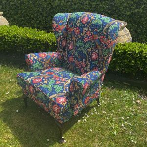 Up-cycled wingback chair in Morris & Co bird fabric