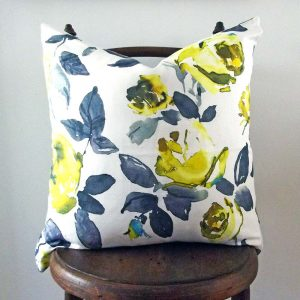 yellow and blue floral cushion