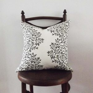 consignment cushion inMokum linen fabric with grey and black flower detail