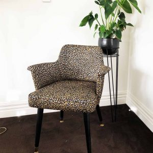 Retro chair in leopard fabric with black and brass legs