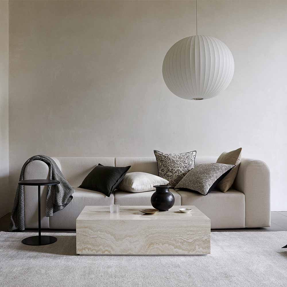 Modern white sofa with Travertine coffee table on Shale rug