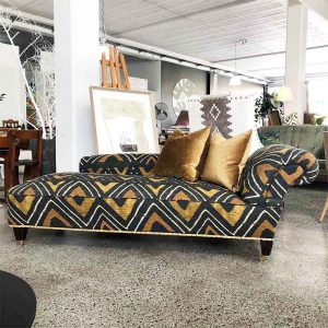 Vintage chaise with modern fabric and brass studs