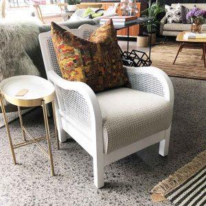 restored white rattan chair