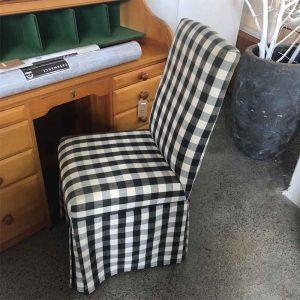 secondhand black check desk chair