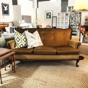 Vintage secondhand gold velvet sofa
