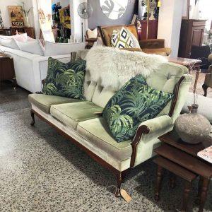 Secondhand sage green vintage sofa