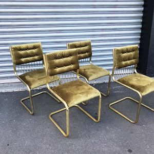 Cantilevered brass and velvet chairs