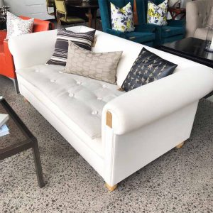 roll arm sofa with tufted seat pad