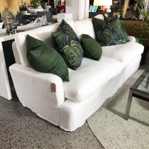 white slip cover sofa