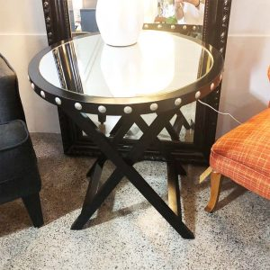 round black cross leg table with mirror top