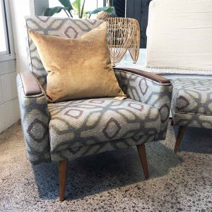 retro chair with wooden arms and matching footstool