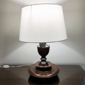 Turned wooden lamp with white linen shade