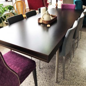 designer dark wood and stainless dining table