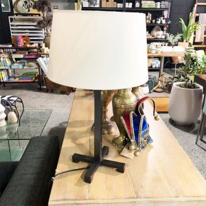 iron cross base lamp with cream shade