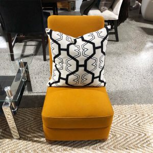 orange slipper chair with storage
