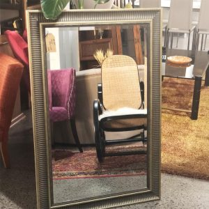 mirror with ribbed edge frame