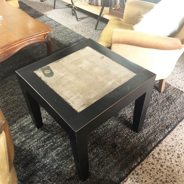 rustic black side table with textured top