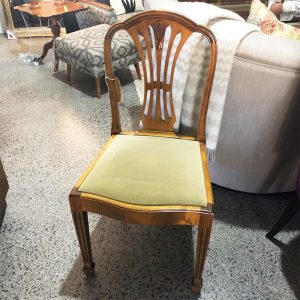curved back solid wood dining chair with green velvet seat