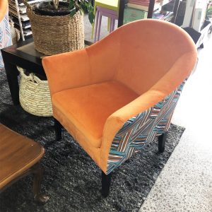 orange chenille tub chair with contrast back